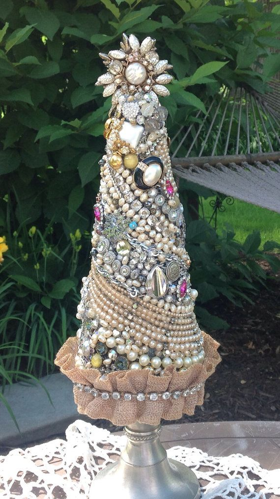 One of a kind jewelry Christmas Tree. Tree stands 16 tall and is adorned with pearls, rhinestones, and other vintage pieces. Pieces include