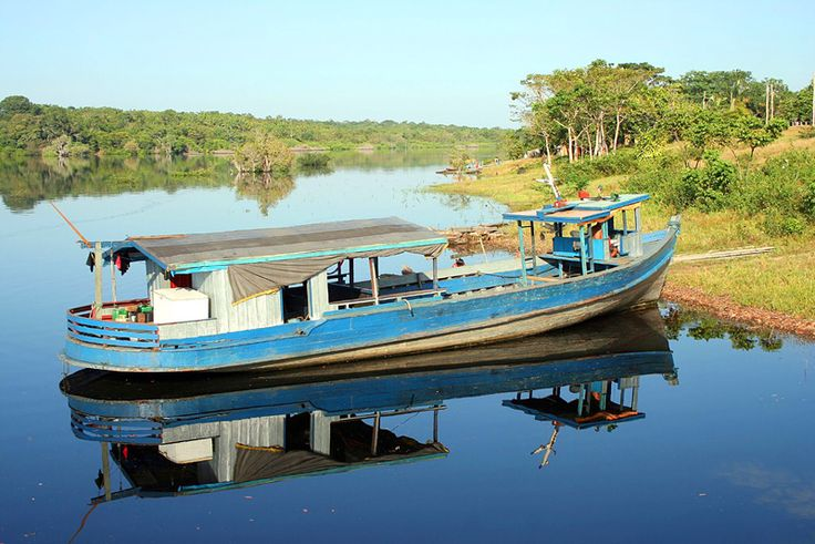 River boat and  calm tributary off the main Amazon River, Brazil