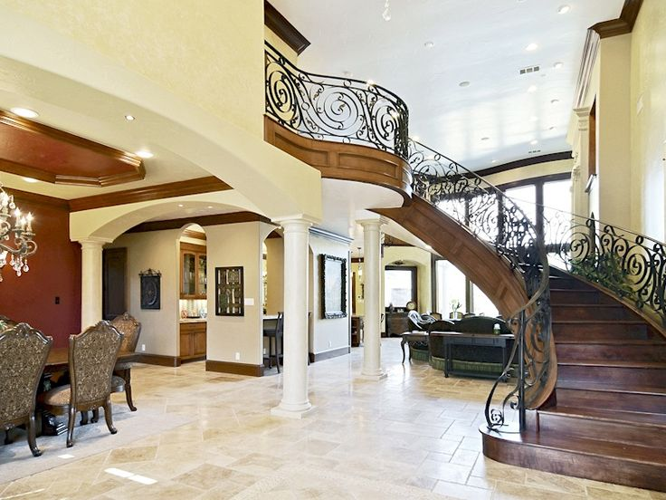 This custom-built villa combines the beauty of Mediterranean-style architecture with modern technology. This six-bedroom Smart Home can be operated from an IPAD. It is energy efficient and features a reverse osmosis drinking system. Inside are ornate fireplaces and a wrought-iron staircase. An executive study has a private entrance; an open kitchen is equipped with Viking appliances, and the master suite is downstairs. An outdoor oasis includes a saltwater pool, spa and bar.