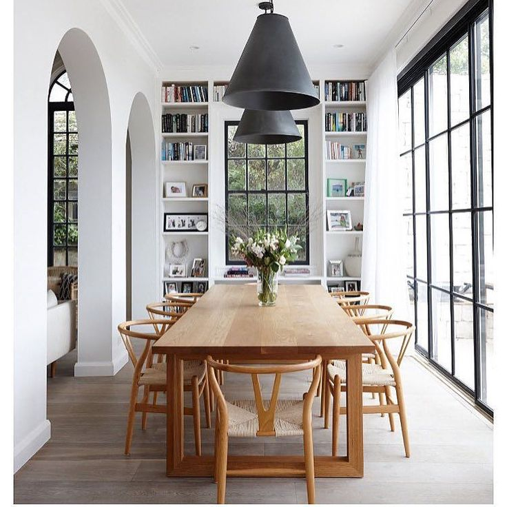 From the wishbone chairs to the steel frame windows... Don't know where to look first @thegracetales via @darrenanddeanne #loveatfirstsight #interiordesign #interiors #arquitectura #architecture #dreamhome #familyhome #diningroom #wishbonechair #eames #hermanmiller #blackwindows #light #realestate #thestylephiles by thestylephiles