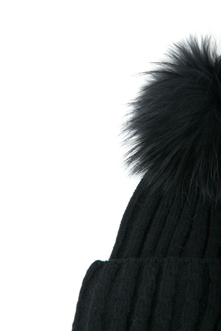 Black pom pom beanie. http://www.modaboom.com/accessories/beanies/product-265/