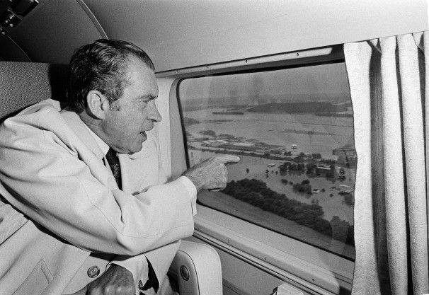 President Richard Nixon studies the flood damage in the aftermath of Hurricane Agnes, near Harrisburg, Pa., from his helicopter window. The president toured the Maryland-Pennsylvania area from his retreat at Camp David, Md.