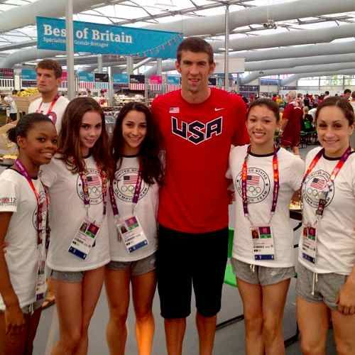 This photo just made my day! Phelps with the Fab Five Gymnasts! Oh the height difference!