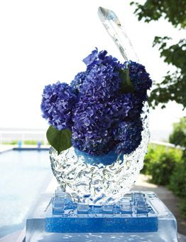Ice sculpture/vase/vodka bar. Awesome, great colour too  -Seaside Heights : Wedding Flowers Gallery : Brides