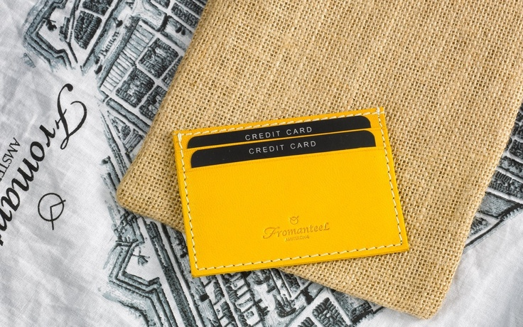 A yellow credit card holder. One of our accessories.