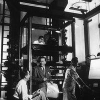 "Walt Disney in multiplane camera room during making of ""Alice in Wonderland"""