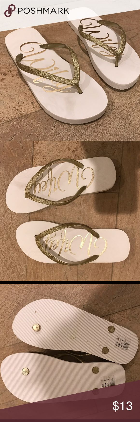 Brides Wifey flip flops in gold sparkle Wifey flip flops writing -and strap in gold glitter. Size is M 7-8. New without tags from Davids bridal. David's Bridal Shoes Sandals