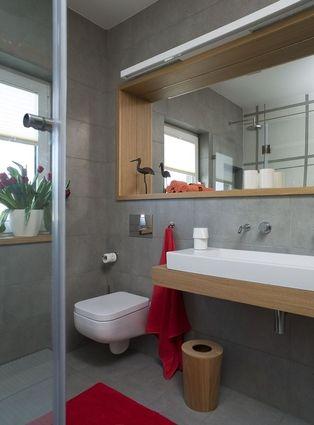 Nowoczesna łazienka w kolorze szarym z czerwonymi akcentami