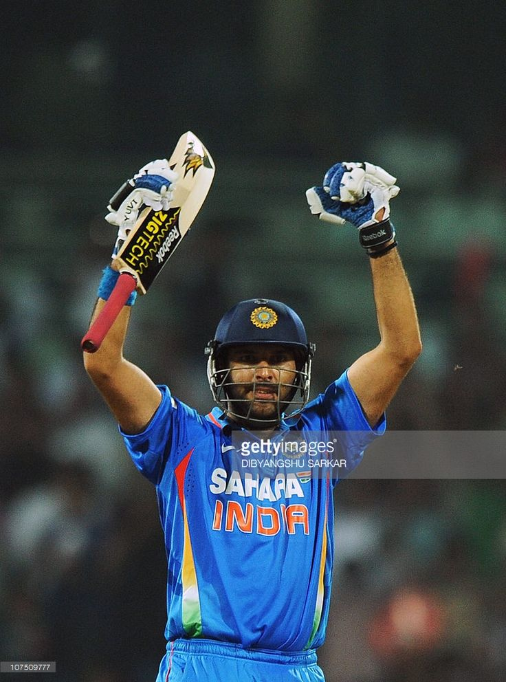 Indian cricketer Yuvraj Singh celebrates the win over New Zealand during the final One Day International (ODI) match between India and New Zealand at M.A. Chidambarm Stadium in Chennai on December 10, 2010. Chasing a target of 104 runs to win India won the match by eight wickets and the five match ODI series 5-0. AFP PHOTO/Dibyangshu SARKAR