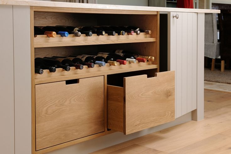 Oak wine unit with cut-out handles by ADK Cabinetworks. Photo by Pete Maltbie