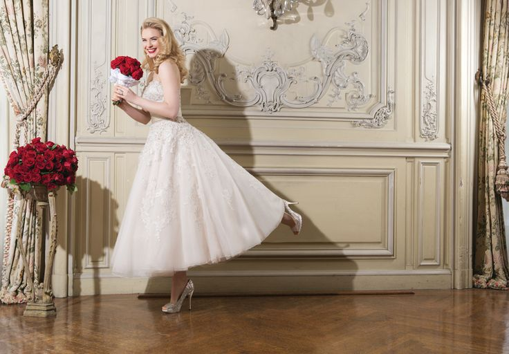 Keep it short and sweet on your wedding day with this tea length wedding dress.