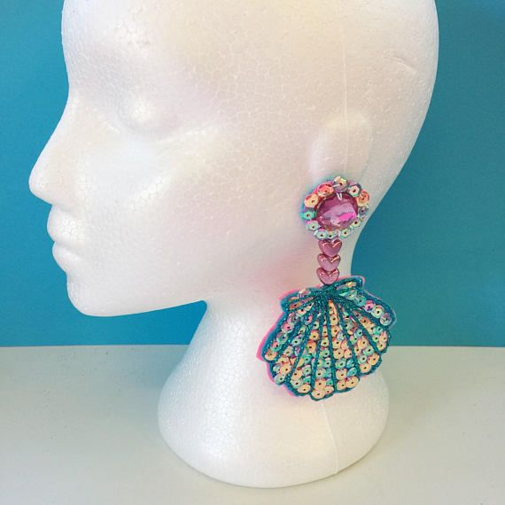 Hand Embroidered Earrings These stunning and incredibly sparkly pink and turquoise mermaid shell dangle earrings are made with surgical steel, hypo-allergenic studs. They are very light weight because of the materials used, being made with sequins that are hand sewn onto felt, with