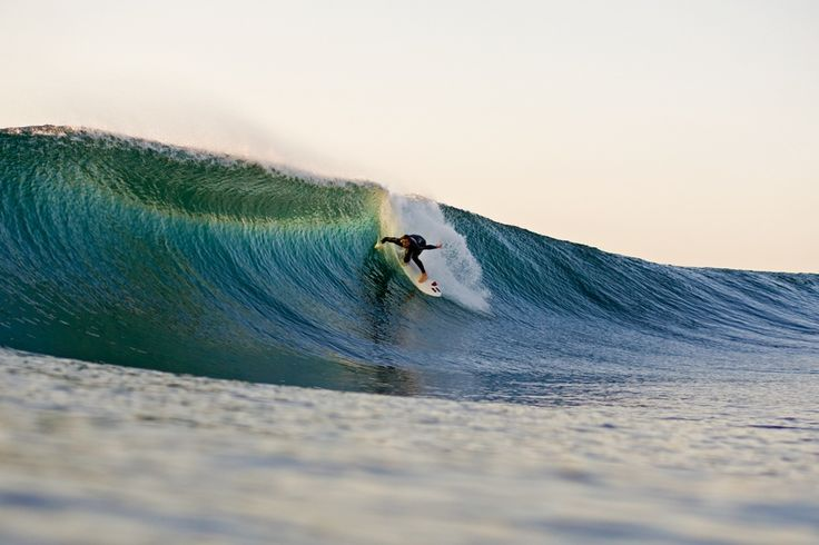 Just after dawn, Mickey Brennan makes first tracks through a New South Wales tube, where a gang of jet-skis and bodyboarders usually swarm by late morning. Photo: Hilton Dawe