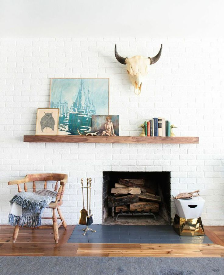 love this simple, off-center floating mantle