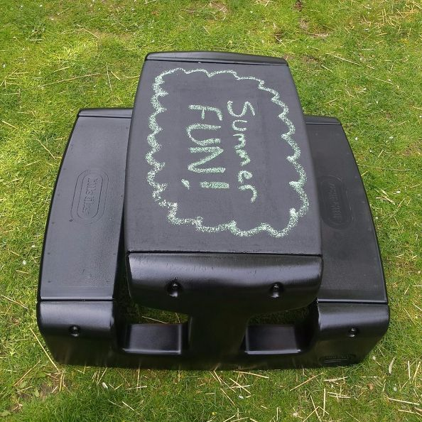 Little tikes picnic table painted black and the top painted with chalkboard paint - clever!