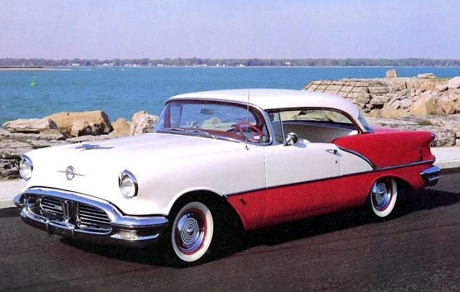 Red and White 1956 Oldsmobile.  Seriously, the two-tone design in older cars is …