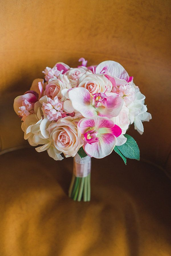 Exotic wedding bouquet idea: Orchids and roses.