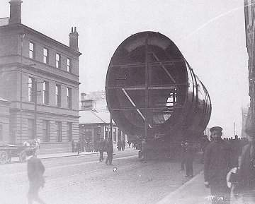 One of the Titanic's four funnels being taken to the quay.