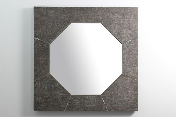 The Keslo wall mirror is a contemporary mirror with echoes of the past. The mirror frame is made in stainless steel with designer charcoal grey linen giving it an elegant blend of textured linen and polished metal. The hexagon shaped mirror looks stylish in both modern and traditional interiors as a hall mirror, console table mirror or living room mirror.