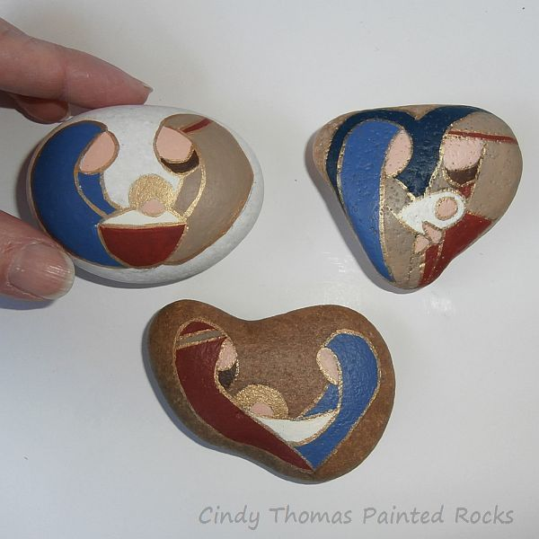 Similar yet different nativity scenes hand painted on small stones