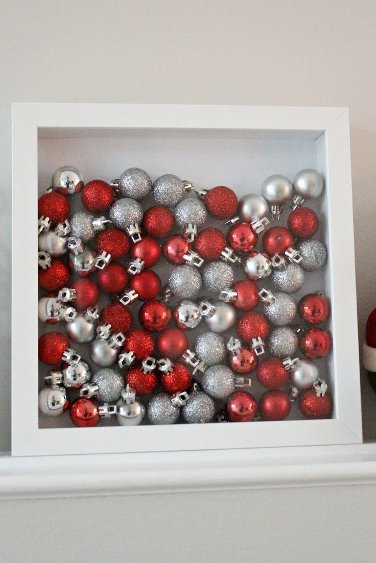 (Ikea) shadowbox + ornaments = instant Christmas decor! Love this-but I'll have to use my blue and silver and snowflake decorations for this.