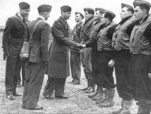 """Pilots of No 46 Squadron RAF meet King George VI at their dispersal point at RAF Digby on 2 November 1939. The royal visitor was welcomed by S/L Kenneth BB """"Bing"""" Cross and spend nearly 10 minutes with the airmen, before moving on to inspect other units, passing on the way maintenance and HQ flights who were drawn up near the hangar."""