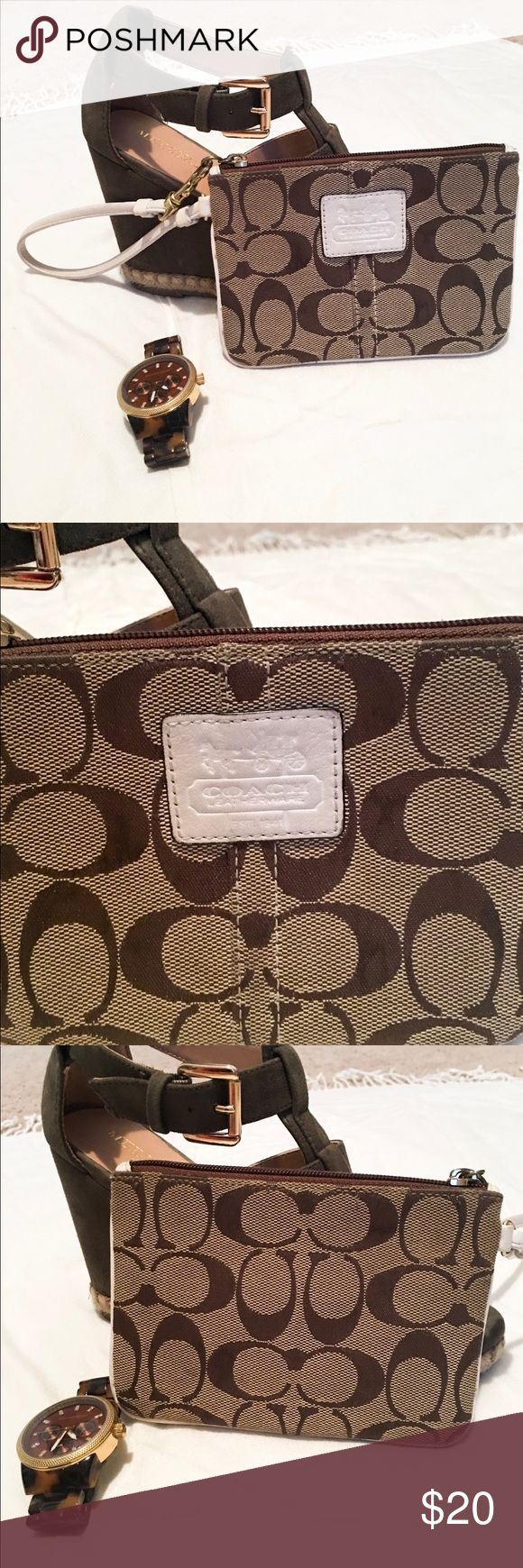 Coach clutch! Small coach clutch!  Great for taking ID and money out for the night or used inside a larger bag as a wallet!!  Does not fit iPhone plus.  Minimal use!  Make me an offer :) Coach Bags Clutches & Wristlets