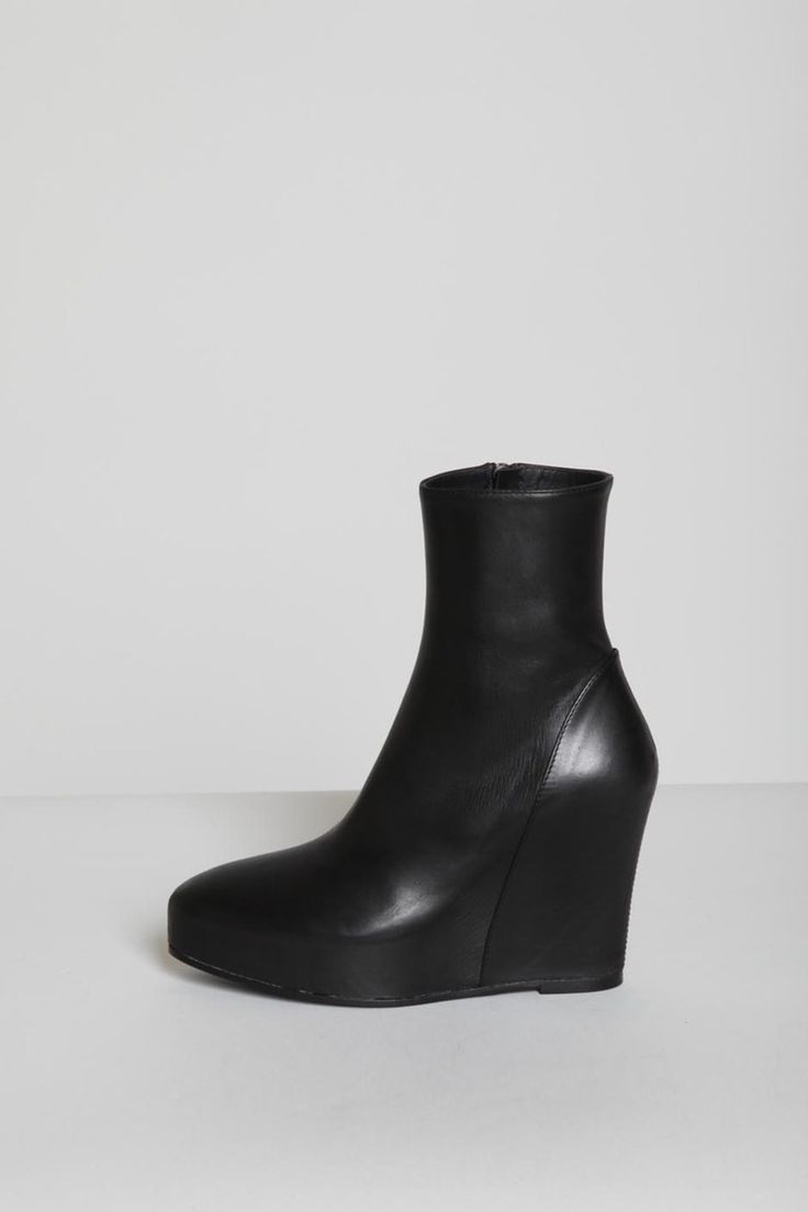 Alison Mosshart's boots: Ann Demeulemeester - Black Hidden Wedge Ankle Boot. Sold out everywhere (but I bought a different pair of boots today that are similar enough to make me quite happy)