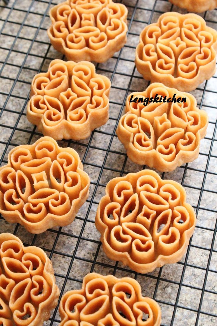"More Chinese New Year cookies!!! Beehive cookies, honeycomb cookies, kuih loyang, kuih rose or we call it ""kueh lobang"" (in Hokkien) even..."