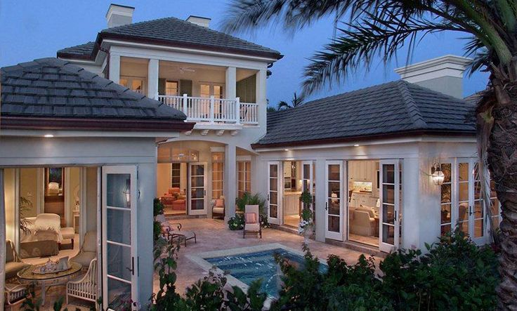 Custom Homes | British West Indies | John McDonald Co. | Custom Home Builder [Love the courtyard-like layout but would want a different style of house. Like the idea of lots of tall windows and one or two sets of French doors but would prefer more traditional divided panes.]