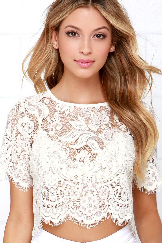 Achieve an effortlessly sexy look by pairing the Glamorous Slowly but Sheerly Cream Lace Crop Top with your favorite jeans and a pair of heels! Sheer eyelash lace is chic and sophisticated as it forms a rounded neckline and delicate half sleeves with eyelash trim. A scalloped bottom hem finishes the straight-cut bodice. Exposed silver zipper at back. Unlined and sheer. 70% Cotton, 30% Polyester. Hand Wash Cold or Dry Clean.