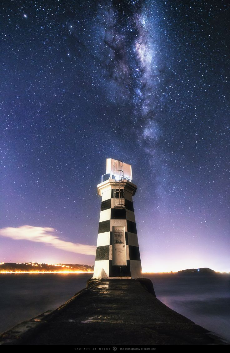 """Night Beacon - The galactic center of our Milky Way rises high above the Point Halswell Lighthouse in Wellington, New Zealand. The night I shot this was really windy and difficult conditions to photograph in, but I did manage to do a Facebook live broadcast of the shoot which you can find here: <a href=""""https://www.facebook.com/markgphoto/videos/10153764333051099/"""">https://www.facebook.com/markgphoto/videos/10153764333051099/</a> Keep up to date with my latest photos on <a…"""