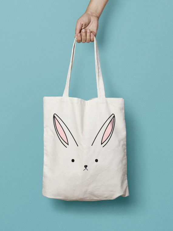 "Bunny Rabbit Tote Bag Canvas Printed , Market Bag,  Totes are that universal product that everyone needs and uses. A book bag, a grocery bag, or just somewhere to throw in all of those little everyday items.  100% Bull Denim Woven Cotton construction Dimensions: 14 3/8"" x 14"" (36.5cm x 35.6cm) Dual handles Fabric weight 11.0 oz/yd² (373 g/m²) Superior screen printing results A cute, all-purpose natural cotton canvas rabbit tote bag."