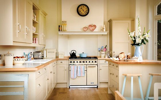 900 Deluxe in classic cream pictured here in a Shaker kitchen by John Lewis of Hungerford is complemented by pastel pink and blue accessories.