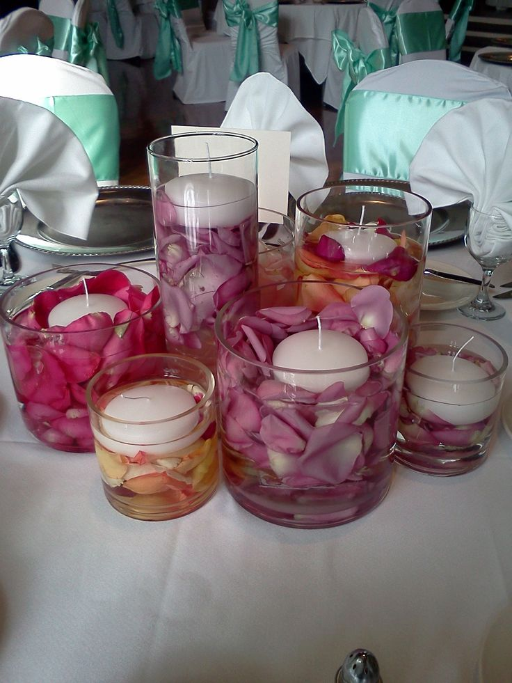 Pink rose petal centerpiece with floating candles