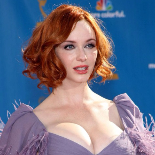 Christina Hendricks.  Hooters are a bit much but love the hair!