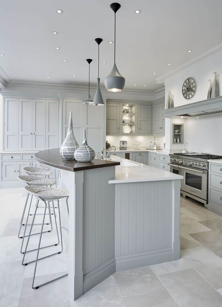 This grey family kitchen is a contemporary take on classic shaker kitchen design, the island caters for all your kitchen dining needs.