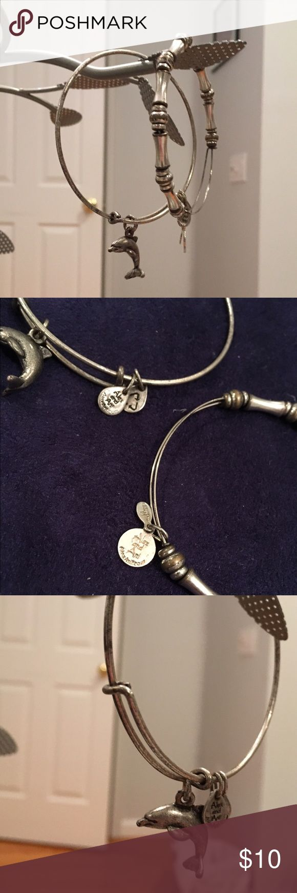 Authentic Alex&Ani silver bracelets Authentic silver Alex&Ani collectible bracelets. The dolphin charm and bamboo beaded bracelets have some tarnishing due to normal wear, but they are still in good shape. They will surely compliment your every day look and can be worn individually or with as many as you like. If you currently own other Alex&Ani bracelets try mixing and matching the gold with the silver! This is a package deal of $10! (All other bracelets are not for sale) Alex & Ani Jewelry…