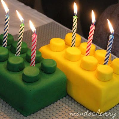 I like these lego cakes - since its in December may go with red and green, plus his fav color, blue