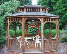 Concerting Hexagon Gazebo Plans with White Chairs Applied