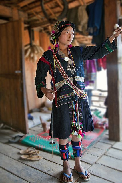 Akha Weaver in a village along the Akha trek, Laos