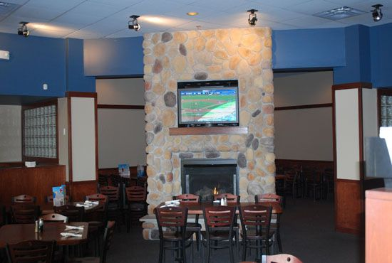 Cozy up by the fireplace at our Ankeny location!
