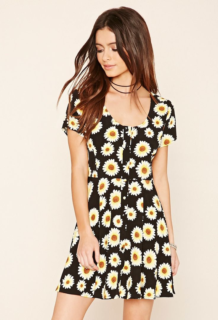 A woven A-line dress with a buttoned front, a round neckline, cap sleeves, and an allover sunflower print.