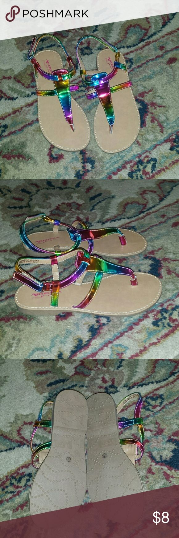 Girl's Rainbow Sandals Up for sale is a pair of Rainbow Sandals by Arizona Jeans. They are a size 2.  These have never been worn. Arizona Jean Company Shoes
