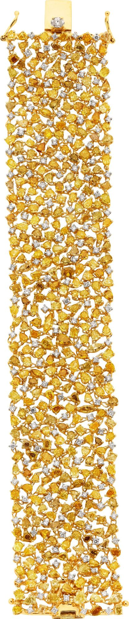 Fancy Yellow Diamond and Gold Bracelet. Sold by Heritage Auctions - Valued at $60,000 with a total carat weight of 33.01 carats