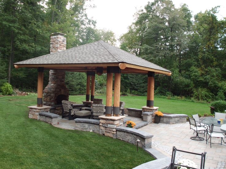 pavilion built into columns on paver patio with sitting