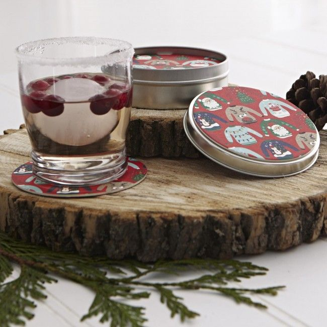 """Protect your tables while still adding a subtle touch of holiday decor with Harman Christmas Tin Round Paper """"Ugly Sweater"""" Coasters. Available in festive red, you get 12 of these coasters at an incredible price!"""