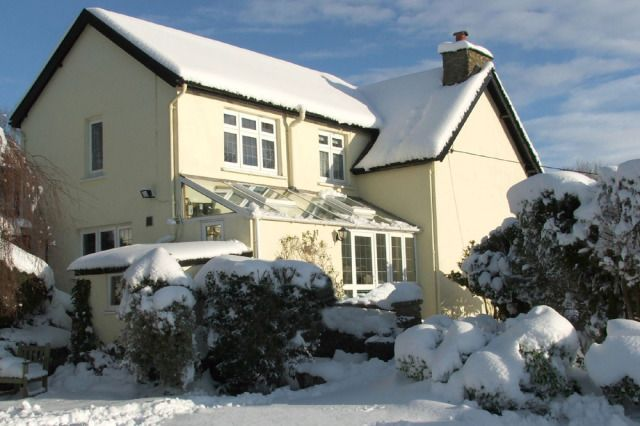 (PHOTO: Stock image. holidaycottages.co.uk)   Where to go for a white Christmas:  Hole up in a festive cottage in Devon: Want your white Christmas in the UK? Holidaycottages.co.uk is offering to make your dreams of a white Christmas a reality this year by working with expert teams to use state-of-the-art snow and winter effects right outside your holiday cottage front door, as well as a fully dressed Christmas tree, fairy lights and tinsel galore inside.