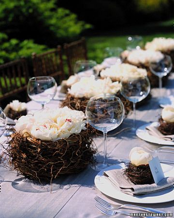 White Wedding Flowers  Bird Nest Centerpieces with Peonies    Large, open peonies settle into nests of twisted fern vines. Inside each basket is a shallow plastic bowl of water (for extra stability, use a wire grid to hold stems in place). A smaller nest atop the napkin at each place holds a more closed flower; its stem sits in a water tube concealed within the nes        Read more at Marthastewartweddings.com: Wedding Flowers by Color – Martha Stewart Weddings