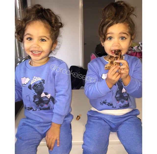 Twins with curly hair in a cute bun